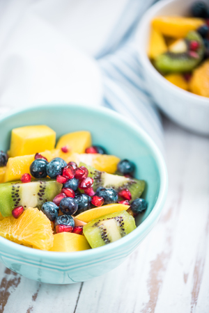 fruity salad: fruity salad for heathy brunch with mango,orange,berries and pomegranate and kiwi