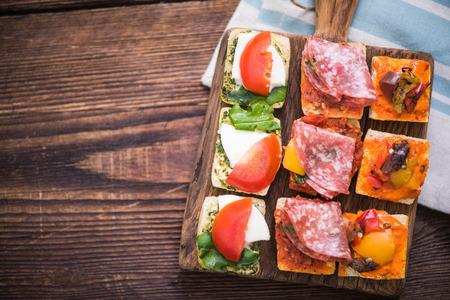 antipasti: antipasti tapas served on wooden rustic board