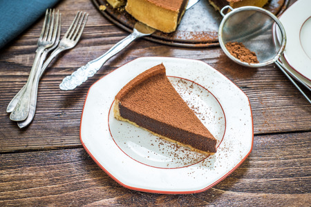 tort: serving chocolate tort with cocoa on wooden table