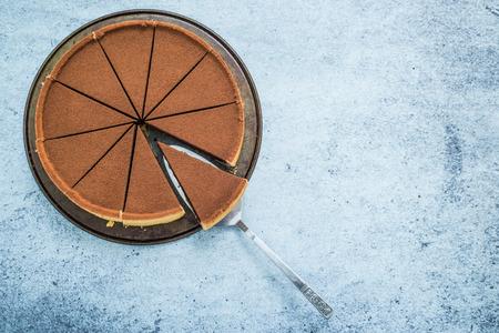 chocolate cake sliced for sharing, overhead view Standard-Bild
