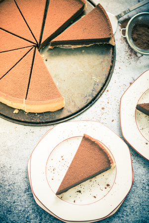 tort: serving chocolate tort on plate , vintage tonned effect