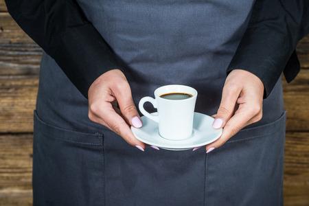 hospitality staff: waitress bartender serving espresso coffee Stock Photo