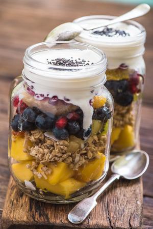 fruity salad: heathy breakfast fruity salad with chia and basil seeds served in mason jar