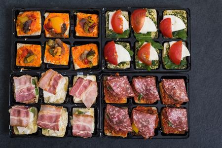 antipasti: selection of antipasti spanish tapas on dark slate Stock Photo