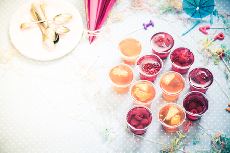kids birthday party: fruit jelly, birthday or garden kids party vintage tonned effect