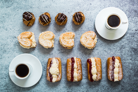 patisserie: sweet patisserie cakes and coffee, overhead flat lay