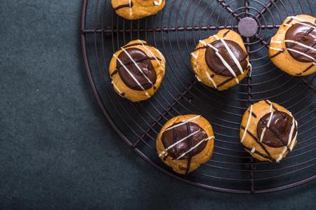 profiterole: profiterole mini eclair sweet food decorated with chocolate