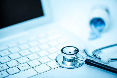 stetoscope: medical stetoscope on computer keyboard