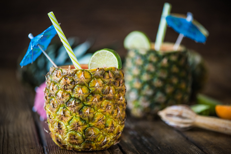 tropical juice with lime in pineapple for summer party