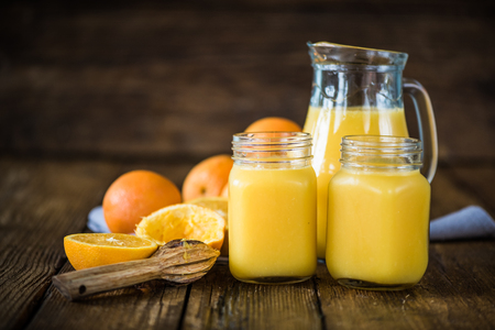fresh hand squeezed natural orange juice in mason jars