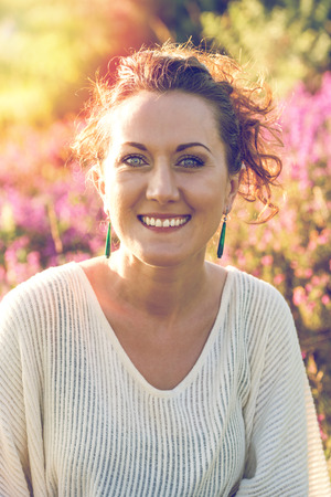 young woman outdoor in heathers, pastel colors and sun flare Stock Photo