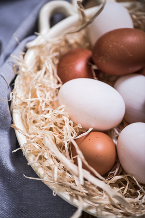 free range: free range fresh eggs in rustic bowl Stock Photo