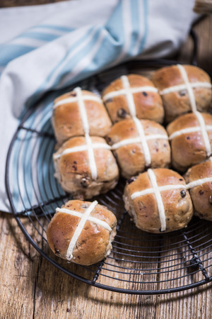 easter cross: Easter hot cross buns on cooling tray Stock Photo