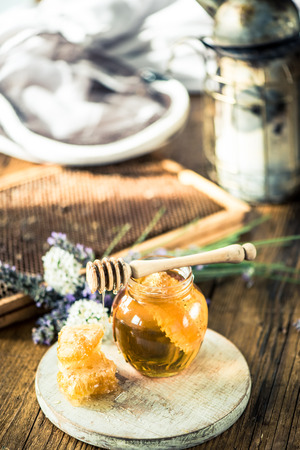 beekeeping: Beekeeping tools and honey with vax comb Stock Photo