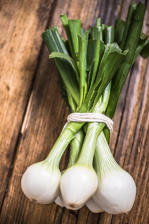 Farm fresh bunch of green onions sold at local market