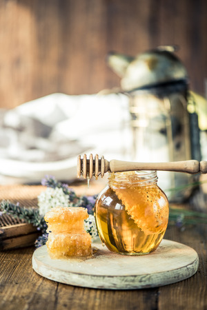 Beekeeping tools and honey with vax comb Stock Photo
