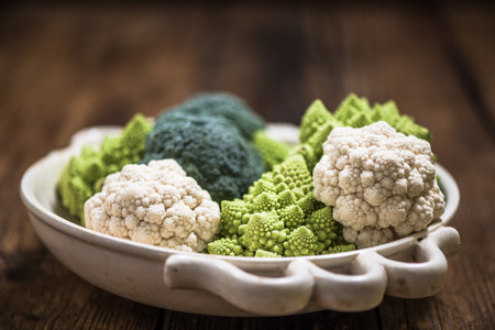 romanesco: cauliflower and broccoli in rustic bowl, autumn vegetables fresh from local market