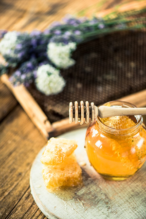 vax: Jar of honey with honey vax comb