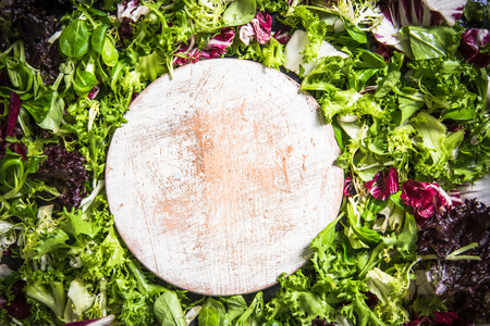 wooden chopping board in salad background with copy space