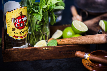 LONDON, UK – SEPTEMBER 3, 2016: Havana Club Rum used to prepare authentic Cuban Mojito cocktail. Reklamní fotografie - 62056220