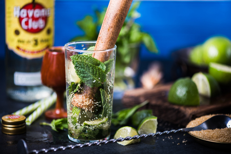 LONDON, UK – SEPTEMBER 3, 2016: Havana Club Rum used to prepare authentic Cuban Mojito cocktail. Stock Photo