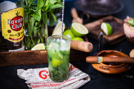 LONDON, UK – SEPTEMBER 3, 2016: Havana Club Rum used to prepare authentic Cuban Mojito cocktail. Publikacyjne