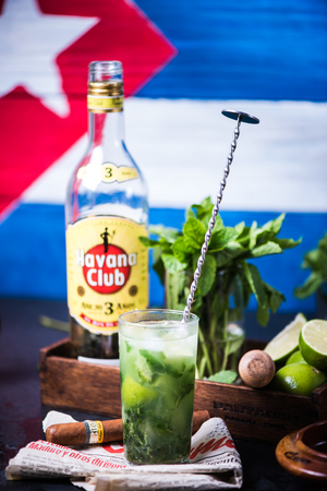 LONDON, UK – SEPTEMBER 3, 2016: Havana Club Rum used to prepare authentic Cuban Mojito cocktail. Editorial