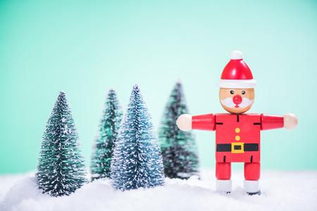 vintage Santa toy selecting Christmas trees in deep snow
