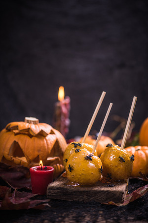 Spooky party Halloween food, apple candy with spiders and worms