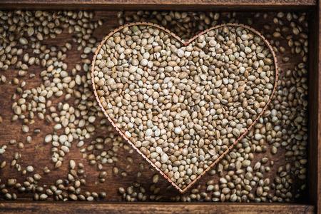 forbidden love: Hemp marijuana seeds in heart symbol