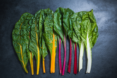 Rainbow chard on dark slate, from above Banque d'images