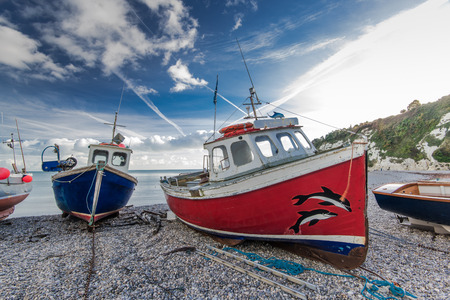 pebles: Fiherman boats on pebles at beach in Beer, Devon,UK. Jurassic coast british heritage.