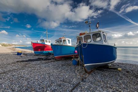 pebles: Fiherman boats on pebles at beach in Beer, Devon,UK. Jurassic coast british heritage.