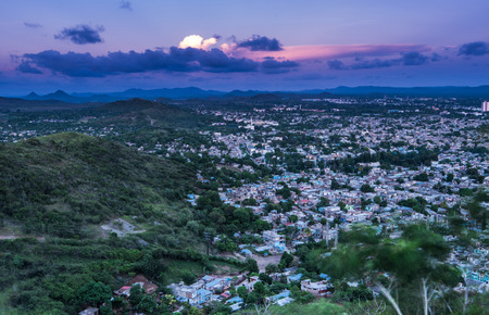 caribe: Aerial view on city of Holguin in Cuba at dusk.