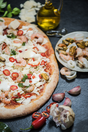 crust: Seafood traditional pizza on thin crust, restaurant quality