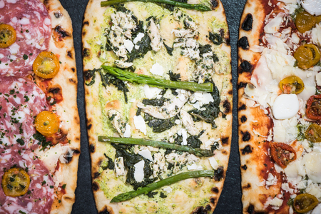 woodfired: different healthy pizza, overhead view Stock Photo