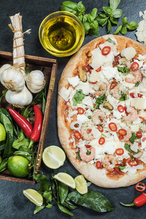 woodfired: making healthy seafood pizza from scratches Stock Photo