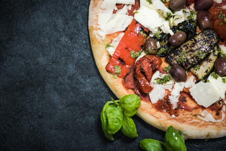 woodfired: wood fired pizza with grilled vegetables on dark slate