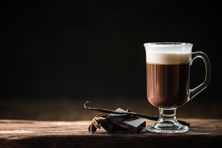 Irish coffee on dark background with space for menu