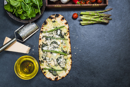 woodfired: asparagus and chicken green pizza on wood fired thin crust