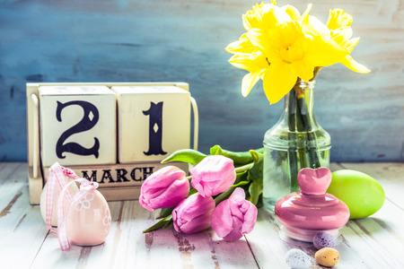 21st March first day of Spring, decoration on wooden table