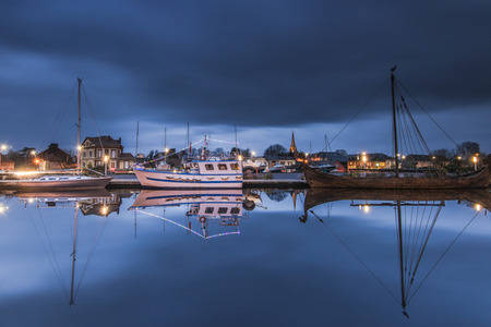 manche: Carentan maritime harbour at twilight, long exposure with reflections in water