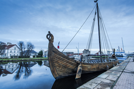 manche: Old wooden historic ship in Carentan quay,France at twilight Stock Photo