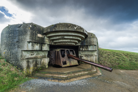 Normandy german defence artillery guns in Longues-sur-Mer, France Stock Photo