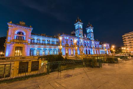 Illuminated City Hall in San Sebastian at twilight, Spain.
