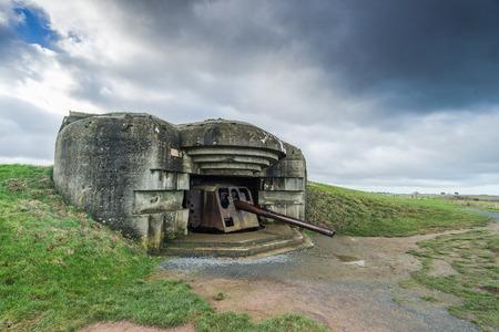 Normandy german defence artillery guns in Longues-sur-Mer, France Фото со стока