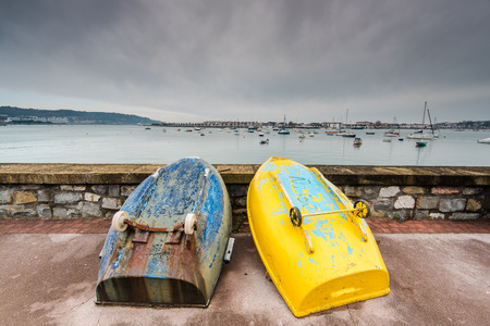 pays: Sea promenade at Saint-Jean-de-Luz, France on cloudy and moody winter day. Stock Photo