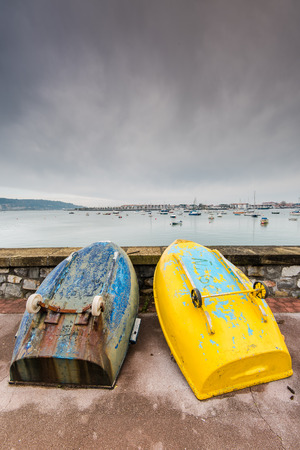 cloudy moody: Sea promenade at Saint-Jean-de-Luz, France on cloudy and moody winter day. Stock Photo