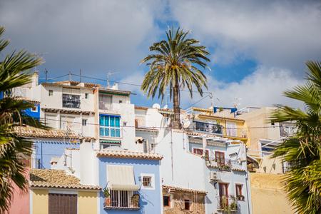 Traditional colorful facades in Villajoyosa in Spain. Famous tourist destination. Stock Photo