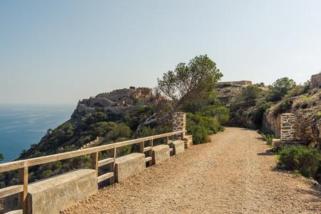 Ruins of Cabo Tinoso Cartagena Guns near Mazarron Murcia Spain at sunny day. Stock Photo